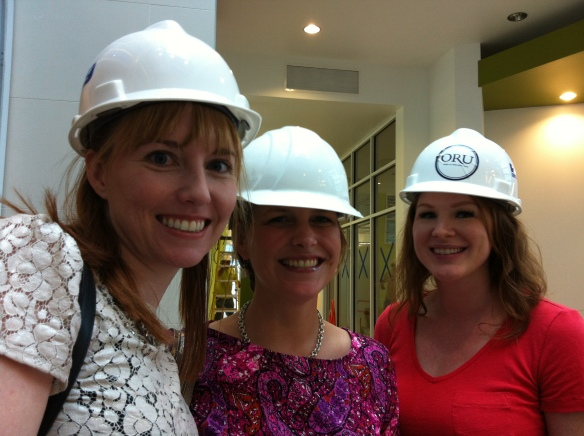 Shannon, Monica and Jenna sport the required hard hats on site. No way are these stylish, but then neither is a concussion.