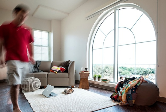 Oversized windows bring in natural light, which is shown to improve not only mood but also productivity.