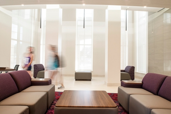 Common areas such as student lounges feature natural light and porcelain tile with comfy seating. We like to create spaces where kids want to just hang out.